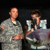 Sarah Palin meets an Asian carp.