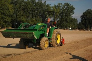 Ernie Krygier using his tractor to clean up the beach. Photo: Baycounty-mi.gov.