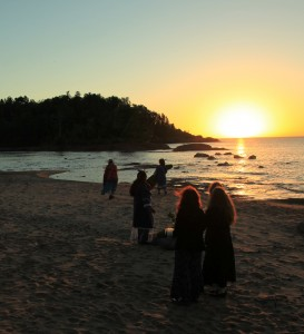 Keweenaw tribe members and locals have a sunrise ceremony of prayer and drumming to protect their water on Lake Superior Day 2010. Photo: Chauncey Moran.