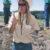 USDA soil scientist Frank Gibbs points to worm passageways in a lump of clay that help plant roots and water penetrate northwest Ohio soil. Image: Tom Henry