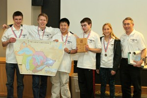 The winning team, Greenhills High School from Ann Arbor, Michigan, pose with their first place medals.