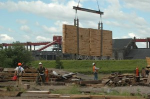 A segment of wall slab from the elevator being lowered. Photo by Janet McReynolds.