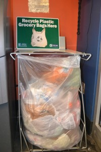 The recycling bin at Whole Foods Co-Op sits right in the entrance, next to the ATM machine. When it fills up, the Western Lake Superior Sanitary District comes to pick up the bags to recycle in other ways. Photo: Jenae Peterson