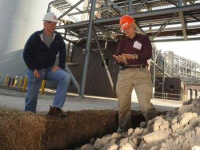 Ohio State scientist Warren Dick, right, says a byproduct of coal-burning power plants called FGD gypsum, shown here in the foreground, can be used to improve farm soils, crop yields and Lake Erie. Photo: K.D. Chamberlain