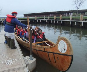 Participants in the 2011 symposium in Ashland, Wis. embark on a canoe trip on Lake Superior