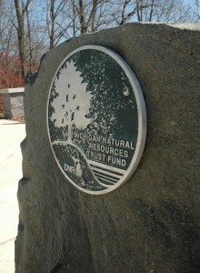 A plaque dedicated to the Michigan Natural Resources Trust Fund stands at Greenview Point Park in Lyons, MI. The park received a $144,700 grant for improvements in 2005. Photo: Becky McKendry.