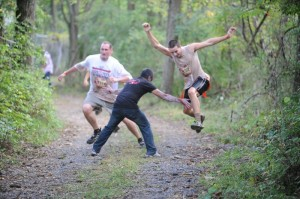 A runner dodges a zombie in his path at Wolf Oak Acres, Oneida ,NY. Photo: Wolf Oak Acres, Zombie Run Facebook page