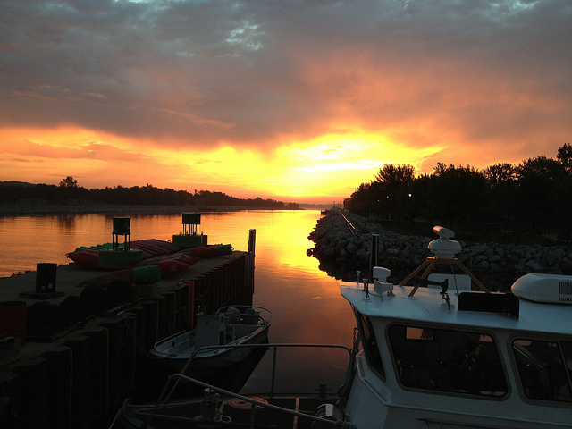 This photo, take on June 12, shows a colorful sunrise over the Muskegon Lake channel. Photo: National Oceanic Atmospheric Administration, Great Lakes Environmental Research Laboratory