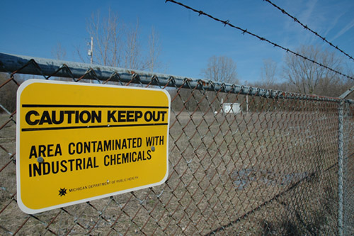 A sign at the Ionia City Landfill, one of the National Priority List sites in Ionia, Michigan. The landfill has been on the list since 1983 and was the site of a waste explosion in the mid-60s, which killed a waste hauler. The site was also used as a baseball facility in the 80s until exposed drums of chemicals were noticed and the field was torn down. Photo: Becky McKendry.
