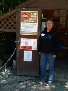 Sallyanne Morris at the boat-washing station that has helped keep Big and Little Glen lakes nearly invasives-free. Photo: Leslie Mertz.