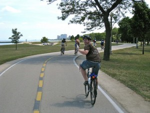 A cyclist enjoys the biking trail along Lake Michigan in Chicago's Burnham Park. Chicago received three and half park benches on Park Score. Photo: Steven Vance, Flickr