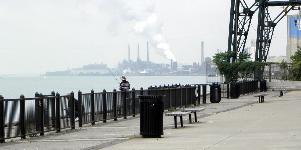 Fishing along the Detroit River near the Ambassador Bridge, looking back at Rouge pollution. Photo:Karen Schaefer.