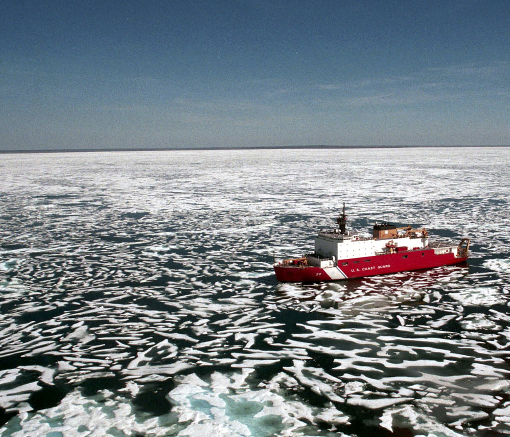 A United States Coast Guard icebreaker navigates icy water. (Coast Guard Digital Photo)