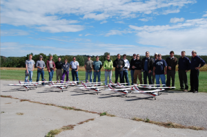 A group of Northwestern Michigan College students and instructors pose with the program's fixed-wing drones. (Photo: Northwestern Michigan College)