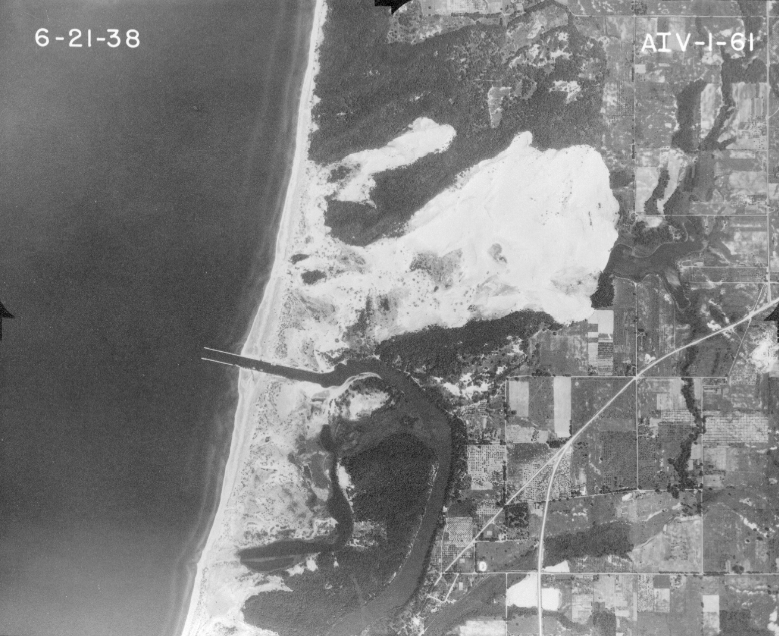 Singapore, Mich. was buried by sand in the 1870's after the area was deforested and the dunes shifted. This photo from 1938 shows the empty area where the ghost town lies. Image: MSU Aerial Imagery Archives