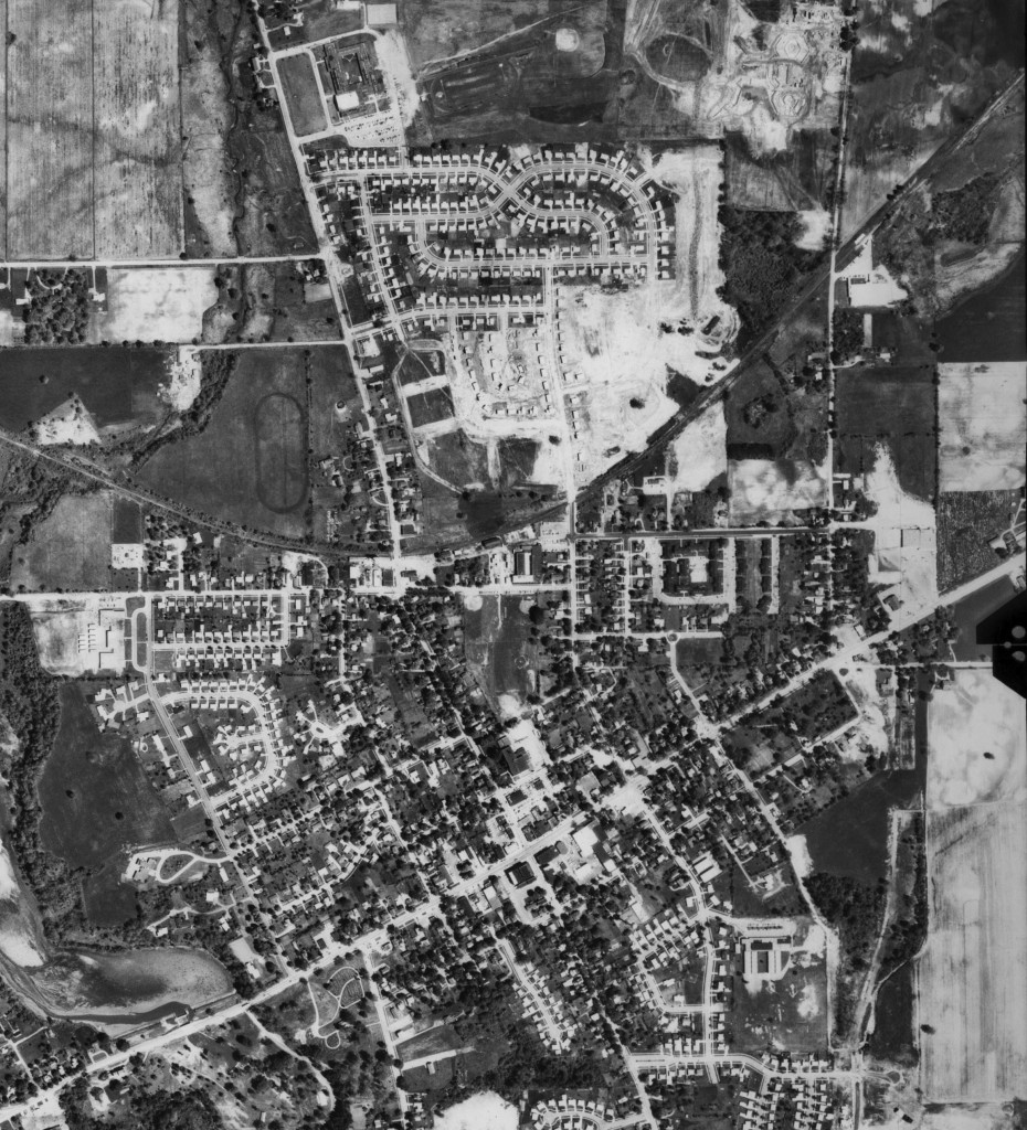 Saline, 1969: The obvious difference here is the new neighborhood that's developed north of the city's center. Though obviously not yet completed, this is the first significant expansion away from the center of Saline. Just a little further north and at the top of the picture is the city's newest school. East of that is Saline's former high school under construction.