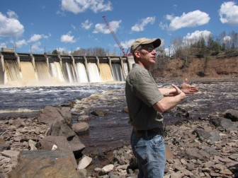 Daryl Peterson at a dam that blocked sturgeon access to breeding grounds. Photo: Diane Desotelle.