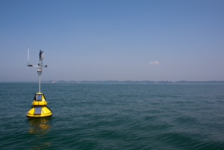 A weather buoy in Lake Michigan. Image by: Ed Verhamme