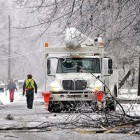 Utility crews work to restore power in North Lansing, Michigan, following a December 2013 ice storm (AP Photo/Lansing State Journal, Robert Killips)