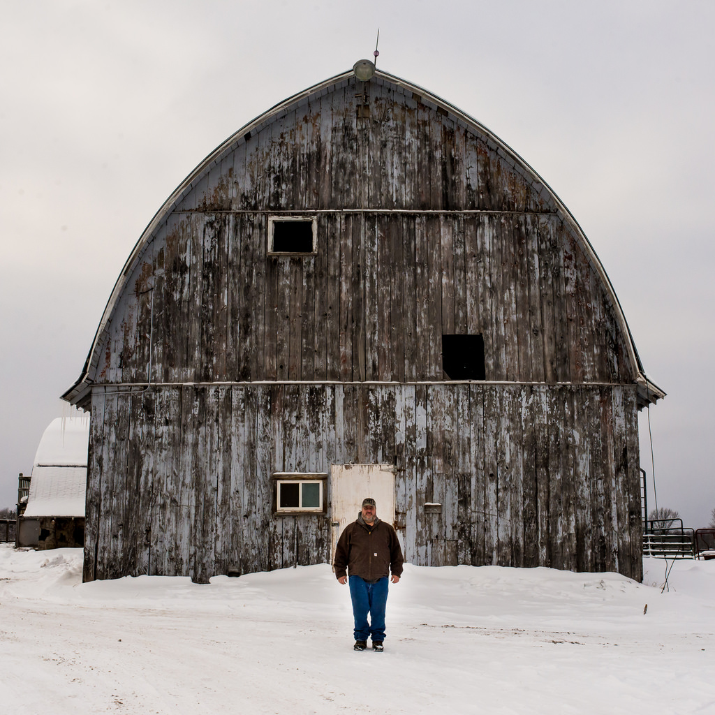 Fifth generation farmer Don Vitek stands in front of his barn in Ashland County, Wisc. The livelihood of his family's farm is threatened by the mine. Image: Al Jazeera America.