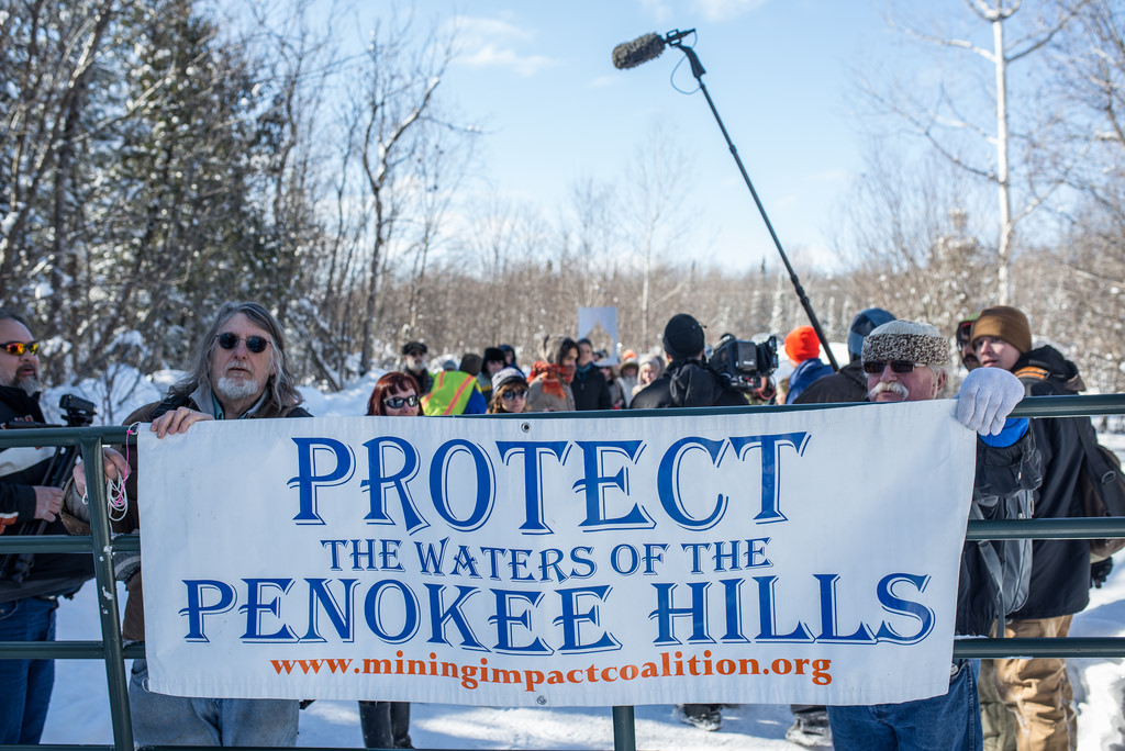 Protestors stand at the entrance of the proposed mine site in the Penokee mountains in northern Wisconsin. Image: Al Jazeera America.