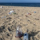 Lake Michigan beach at Grand Haven State Park is left covered in garbage after the Fourth of July. Image: Jamie Cross