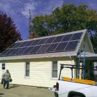 Workers for Michigan Solar Solutions complete an installation in Flint; owner Mark Hagerty says the panels doubled the value of the home. Image:  Michigan Solar Solutions