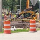 Workers excavate DDT contaminated soil from yards in St. Louis, Mich. Image: David Poulson