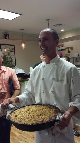 Johnny Blancher explains how he incorporated Formosan termites in the streusel of this peach cobbler. Image: David Poulson