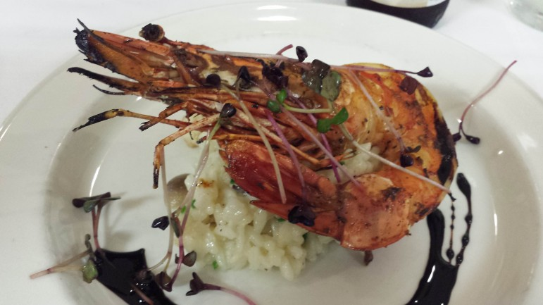 Char-broiled tiger prawn with wild mushroom risotto and truffle essence. Image: David Poulson