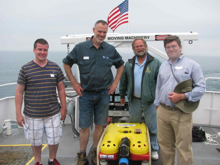 A dive team with a Remotely Operated Vehicle. From right Grand Valley State University faculty members Mark Schwartz and Mark Gleason,  Geoff Cooke of SeaView Systems and a GVSU student. Image: via Mark Gleason