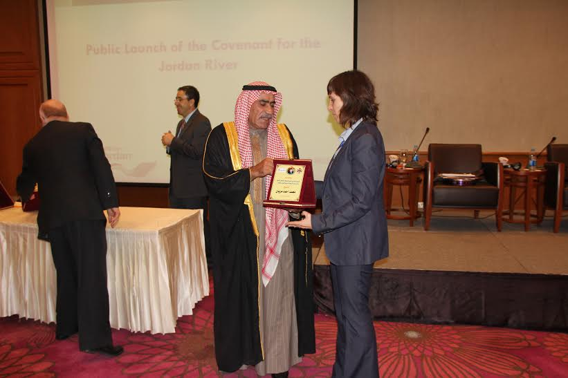 Rachel Havrelock, a professor at the University of Illinois at Chicago, is acknowledged by the Jordanian minister of tourism for her water management efforts in the Jordan Valley. Image: Rachel Havrelock