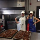 Good Eats Diva owner Kathleen Hanna, right, surveys just baked chocolate biscotti with assistant Kaitlyn Stalk.