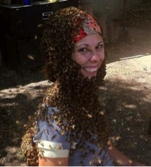"Rebecca Masterman, director of the University of Minnesota's Bee Squad, with a ""bee beard."" Image: Bee Squad."