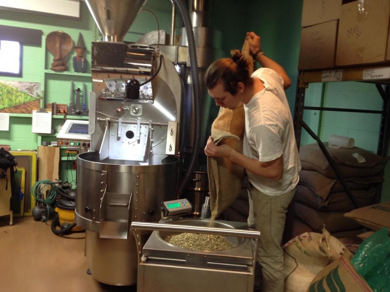 Grant Stewart roasting coffee at Roos Roast, Ann Arbor. Image: Barbara Lucas, WEMU.
