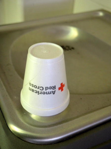 A Red Cross cup covers the water fountain at the National Guard water station. Image: Amanda Proscia