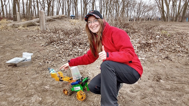 Kennedy with her robot. Image: Robot Missions