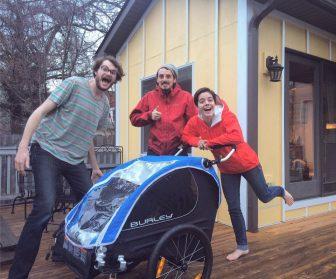 Runners Evan Flom, Alex Butter, Allissa Shutte gather around their new baby stroller. Image: Our Shores