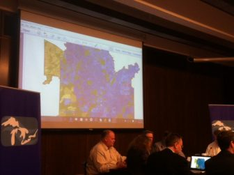 Representatives of the Great Lakes governors consider a map of Waukesha's proposed water needs. Image: Gary Wilson