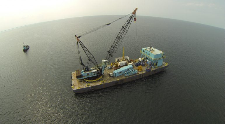 A drone took this image of a barge collecting soil and data from the lake bed of a proposed Lake Erie wind farm in 2015. Image: Lake Erie Energy Development Corp.