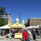 Is this a statement of support for Wisconsin state air pollution control legislation? Or just a pat on the back for state lawmakers?  Naahh, it's just a well-placed tent selling nuts – almonds, cashews, pecans and peanuts -- during an arts fair and farmers market on a street in front of Wisconsin's Capitol in Madison. The building was completed in 1917. Image: Eric Freedman