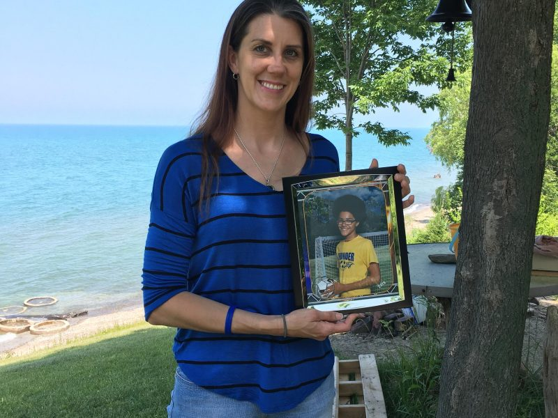 Melissa Zirkle holds photo of son Jermaine. Image: Elizabeth Miller.