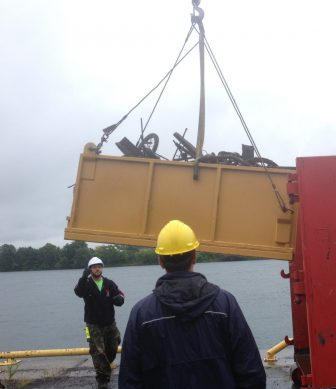 The river cleanup in Cornwall used mobile cranes to pull debris out of the water. Image: Karen Cooper