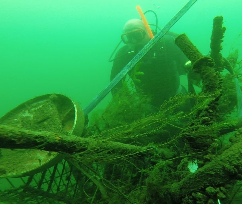 A diver removes garbage that could have been fish habitat. Image: Karen Cooper